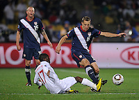 Shaun Wright-Phillips (17) of England tackles Steve Cherundolo (6) of USA. USA tied England 1-1 in the 2010 FIFA World Cup at Royal Bafokeng Stadium in Rustenburg, South Africa on June 12, 2010.