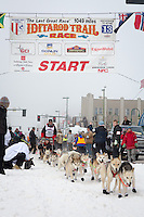 Bob Chlupach and team leave the ceremonial start line at 4th Avenue and D street in downtown Anchorage during the 2013 Iditarod race. Photo by Jim R. Kohl/IditarodPhotos.com