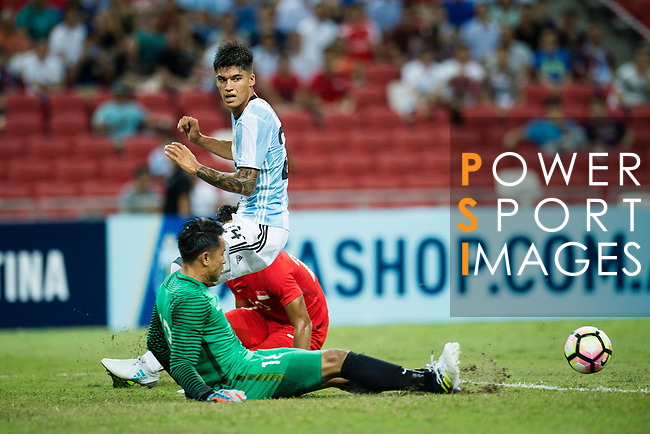 Carlos Correa of Argentina (R) trips up with Hassan Sunny of Singapure (L) during the International Test match between Argentina and Singapore at National Stadium on June 13, 2017 in Singapore. Photo by Marcio Rodrigo Machado / Power Sport Images