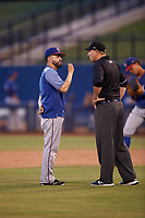 AZL Rangers manager Carlos Cardoza (65) argues with umpire Larry Dillman Jr. during an Arizona League game against the AZL Brewers Blue on July 11, 2019 at American Family Fields of Phoenix in Phoenix, Arizona. The AZL Rangers defeated the AZL Brewers Blue 5-2. (Zachary Lucy/Four Seam Images)