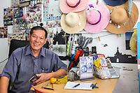 George Town, Penang, Malaysia. Malaysian Shopkeeper.