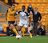 Wolverhampton Wanderers' Romain Saiss (left) battles with Fulham's Ivan Cavaleiro (right) <br /> <br /> Photographer David Horton/CameraSport<br /> <br /> The Premier League - Wolverhampton Wanderers v Fulham - Sunday 4th October 2020 - Molineux Stadium - Wolverhampton<br /> <br /> World Copyright © 2020 CameraSport. All rights reserved. 43 Linden Ave. Countesthorpe. Leicester. England. LE8 5PG - Tel: +44 (0) 116 277 4147 - admin@camerasport.com - www.camerasport.com