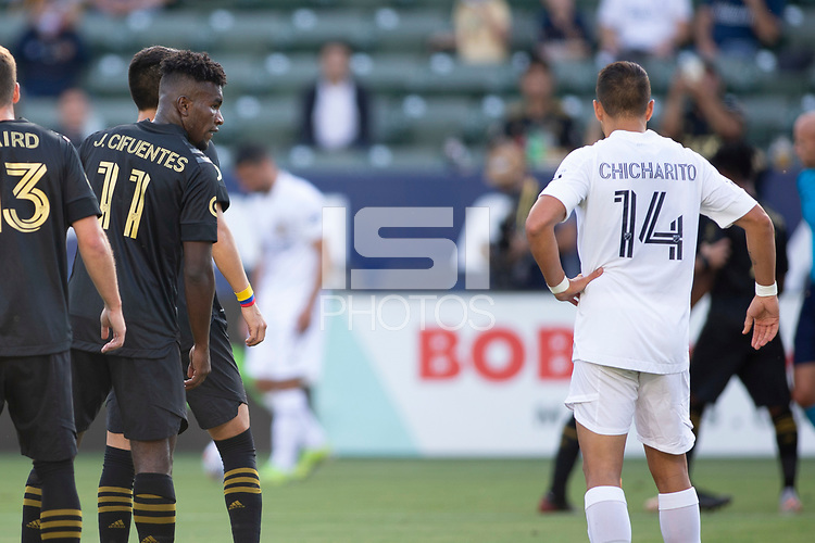 CARSON, CA - MAY 8: Jose Cifuentes #11 of LAFC has a few words with Javier Hernandez #14 of the Los Angeles Galaxy during a game between Los Angeles FC and Los Angeles Galaxy at Dignity Health Sports Park on May 8, 2021 in Carson, California.