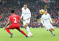 Martin Olsson of Swansea City chips the ball through for Tom Carroll to cross into the box to set up team mate Fernando Llorente second goal of the Premier League match between Liverpool and Swansea City at Anfield, Liverpool, Merseyside, England, UK. Saturday 21 January 2017