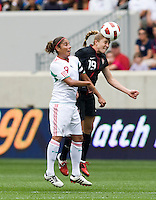 Rachel Buehler (19) of the USWNT  goes up for a header with Maribel Dominguez (9) of Mexico during the game at Red Bull Arena in Harrison, NJ.  The USWNT defeated Mexico, 1-0.