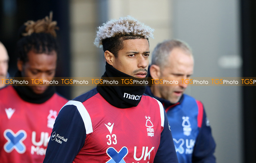 Lyle Taylor of Nottingham Forest coming out to warm up during Millwall vs Nottingham Forest, Sky Bet EFL Championship Football at The Den on 19th December 2020