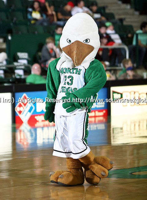 North Texas Mean Green Mascot, Scrappy, takes the court during a time out in the game between the Texas State Bobcats and the University of North Texas Mean Green at the North Texas Coliseum,the Super Pit, in Denton, Texas. UNT defeated Texas State 85 to 62