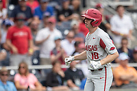 Arkansas Razorbacks outfielder Heston Kjerstad (18) trots around the bases after hitting a home run during Game 5 of the NCAA College World Series against the Texas Tech Red Raiders on June 17, 2019 at TD Ameritrade Park in Omaha, Nebraska. Texas Tech defeated Arkansas 5-4. (Andrew Woolley/Four Seam Images)