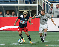FOXBOROUGH, MA - SEPTEMBER 23: Kelyn Rowe #11 of New England Revolution dribbles as Samuel Piette #6 of Montreal Impact defends during a game between Montreal Impact and New England Revolution at Gillette Stadium on September 23, 2020 in Foxborough, Massachusetts.