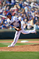 Texas Rangers pitcher Jesse Chavez (30) follows through on a pitch during a Cactus League Spring Training game against the Los Angeles Dodgers on March 8, 2020 at Surprise Stadium in Surprise, Arizona. Rangers defeated the Dodgers 9-8. (Tracy Proffitt/Four Seam Images)