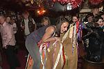The Hooden Horse and Christmas reveler. Sandgate Hoodeners at the the Ship Inn, Sandgate, Nr Folkstone Kent. UK. 2012