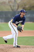 Mitch Stetter #57 of the Milwaukee Brewers participates in pitchers fielding practice during spring training workouts at the Brewers complex on February 18, 2011  in Phoenix, Arizona. .Photo by Bill Mitchell / Four Seam Images.