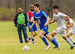 WOODBURY, CT-111120JS23 —Nonnewaug's Zach Thompson (2) runs the ball past Wolcott Tech's Luis Sanchez (8) during their game Wednesday at Nonnewaug High School. <br /> Jim Shannon Republican-American