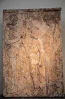 Athens archeological museum Votive relief  (from New Phaleron, Attica) dedicated to the river-god Kephisos  ca.410 BC.  women and a child, archeological museum Votif relief Dedivated to the sanctuary of Demeter and Kore at Eleusis , it represents the Eleusinian deities in a scene of mysteriac ritual (Demeter offers ears of wheat to triptolemos. At right Persephone, holding a torch, blesses Triptolemos with her right hand ( 440-430 BC)
