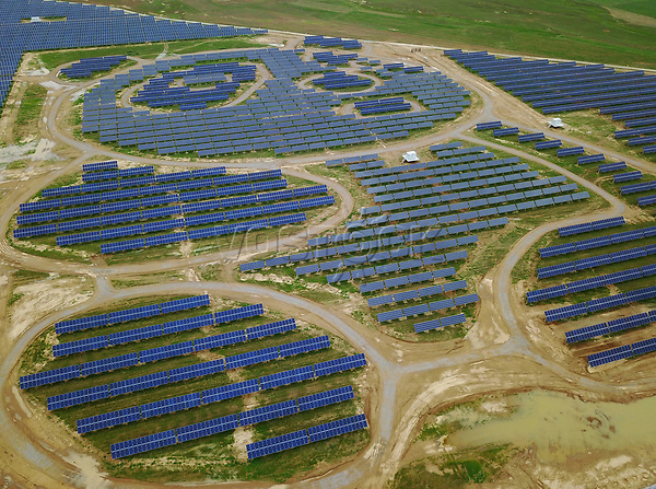 epa06108534 An aerial view taken by a drone shows the Datong Panda Power Plant where solar panels are placed to form the pattern of pandas in Datong, Shanxi Province of China, 25 July 2017. The world's first panda power plant will officially start operations on 10 August 2017, where it will have a total installed capacity of 100MW upon completion, providing 3.2 billion kWh of green energy in 25 years This is equivalent to saving 1.056 million tons of standard coal or reducing 2.74 million tons of CO2 emission according to the company.  EPA/HOW HWEE YOUNG