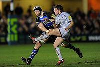 George Ford of Leicester Tigers (right) kicks past the block attempt of Dave Attwood of Bath Rugby during the LV= Cup semi final match between Bath Rugby and Leicester Tigers at The Recreation Ground, Bath (Photo by Rob Munro, Fotosports International)