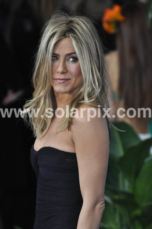 **ALL ROUND PICTURES FROM SOLARPIX.COM**                                             **SYNDICATION RIGHTS FOR UK, AUSTRALIA, DENMARK, PORTUGAL, S. AFRICA, SPAIN & DUBAI (U.A.E) & ASIA (EXCLUDING JAPAN) ONLY**                                                                                  Caption:  arrivals at the Just Go with It premiere, held at the Ziegfeld Theater - New York City, NY, USA. 8 February 2011                                                                            This pic:  Jennifer Aniston                                                                                            JOB REF: 12771 PHZ Smith      DATE: 08_02_2011                                                           **MUST CREDIT SOLARPIX.COM OR DOUBLE FEE WILL BE CHARGED**                                                                      **MUST AGREE FEE BEFORE ONLINE USAGE**                               **CALL US ON: +34 952 811 768 or LOW RATE FROM UK 0844 617 7637**