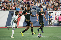 FOXBOROUGH, MA - AUGUST 4: Mark-Anthony Kaye #14 of Los Angeles FC beats Luis Caicedo #27 of New England Revolution to the ball during a game between Los Angeles FC and New England Revolution at Gillette Stadium on August 3, 2019 in Foxborough, Massachusetts.