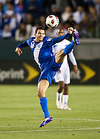 CARSON, CA – June 6, 2011: Guatemala player Marco Pappa (16) kicks the ball during the match between Guatemala and Honduras at the Home Depot Center in Carson, California. Final score Guatemala 0, Honduras 0.