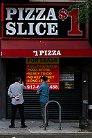 NEW YORK, NEW YORK - JUNE 18: People take a look of a restaurant shuttered due to COVID-19 virus at Hells Kitchen area as city prepares for reopening on June 18, 2020 in New York City. New York City is preparing to enter phase 2 of reopening where restaurants and bars can offer outdoor dining this coming Monday. (Photo by Eduardo MunozAlvarez/VIEWpress)