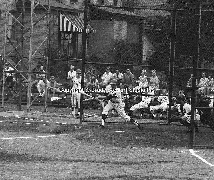 Ford City PA:  Bethel Park vs Arnold to advance to the state American Legion Playoffs.  Bob Purkey Jr getting a base hit during the game.  Bob Purkey pitched a shut out (1-0) and the team advanced to the state playoffs in Allentown PA.  Others in the photo; Mr. and Mrs. Bob Purkey Sr, Mike Stewart, Paul Hauck, Gary Biro, and Bob Colligan.