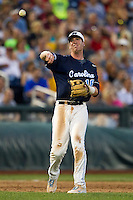 North Carolina third baseman Colin Moran (18) makes a throw to first base during Game 10 of the 2013 Men's College World Series against the North Carolina State Wolfpack on June 20, 2013 at TD Ameritrade Park in Omaha, Nebraska. The Tar Heels defeated the Wolfpack 7-0, eliminating North Carolina State from the tournament. (Andrew Woolley/Four Seam Images)