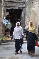 Zanzibar, Tanzania.  Zanzibari Women wearing Scarves and Buibuis.