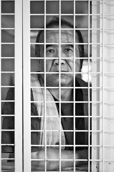 Man In Cage, Sham Shui Po, Hong Kong.