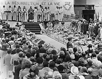 1980 FILE PHOTO - ARCHIVES -<br /> <br /> Funerailles des victimes l' Incendie du Jour de l'an,1980, Chapais<br /> <br /> Funeral for Chapais: More than 2;000 mourners attended a civic funeral yesterday for 40 of 44 people who perished in a New Year fire when pine bought suddenly burst in to flames in a wood-frame building in this north-western Quebec town. Flower-decked coffins lined the hockey arena as mourners gathered beneath a poster reading. 'I am the resurrection and the life.' Jan 1980<br /> <br /> PHOTO :  Jeff Goode - Toronto Star Archives - AQP