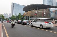 Suzhou, Jiangsu, China.  Street Traffic  in Downtown Shopping Area.