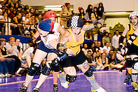 The Brooklyn Bombshells and the Bronx Gridlock clash at a Gotham Girls Roller Derby bout in New York City on July 22, 2006.