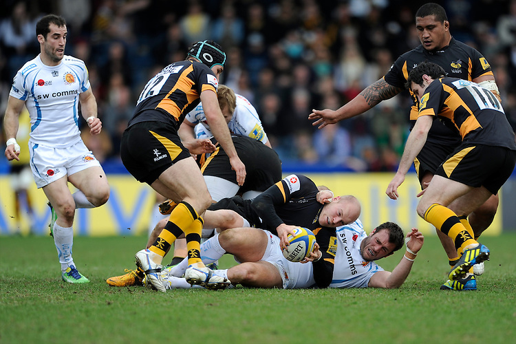Joe Simpson of London Wasps secures the ball despite the efforts of Luke Arscott of Exeter Chiefsduring the Aviva Premiership match between London Wasps and Exeter Chiefs at Adams Park on Sunday 21st April 2013 (Photo by Rob Munro)