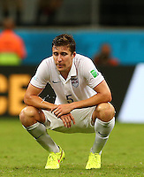Matt Besler of USA shows a look of dejection at full time