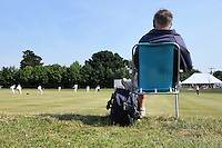 General view as a spectator watches play at Coggeshall cricket club - Essex CCC 2nd XI vs Surrey CCC 2nd XI - Second XI Championship Cricket at Coggeshall Cricket Club - 14/06/11 - MANDATORY CREDIT: Gavin Ellis/TGSPHOTO - Self billing applies where appropriate - Tel: 0845 094 6026