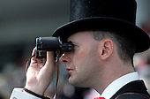 Racegoer in theQueen's Stand at Epsom Downs racecourse on Derby Day.