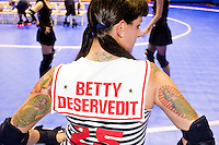 Betty Dersevedit of the Brooklyn Bombshells gets ready to clash against the Queens of Pain at a Gotham Girls Roller Derby bout in New York City on June 2, 2006.