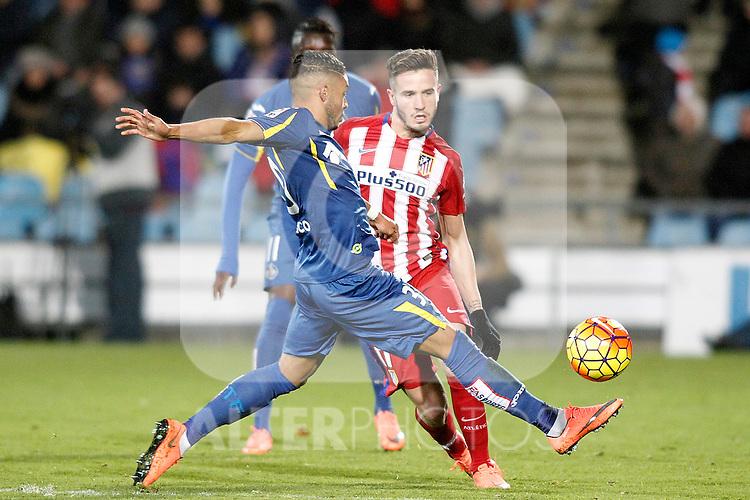 Getafe's Wanderson (l) and Atletico de Madrid's Saul Niguez during La Liga match. February 14,2016. (ALTERPHOTOS/Acero)