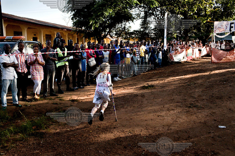 Pollyanna Hope completes the 5km mini marathon on her crutches without any assistance