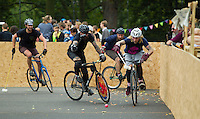 17 AUG 2014 - LONDON, GBR - Players from Big Fun (in blue with the pink logo) and Six Feet Under (in black) chase the ball during the 2014 London Open Bike Polo tournament in Highbury Fields in London, Great Britain (PHOTO COPYRIGHT © 2014 NIGEL FARROW, ALL RIGHTS RESERVED)