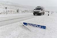 "WEATHER PICTURE WALES<br /> Pictured: A van drives past a ""Police Slow"" sign covered by snow at the side of the A470 road in Storey Arms, Brecon Beacons in south Wales, UK. Friday 02 March 2018<br /> Re: Beast from the East and Storm Emma has been affecting most parts of the UK."