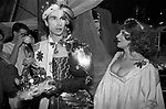 Andrew Logan, artist and organiser of The Alternative Miss World beauty pageant competition with contestant and the Crown that he will place on the head of the winner. Olympia West London 1981. Seen here with actress Fenella Fielding,(1927-2018) <br />
