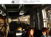 Customers on the mono-rail in Tokyo, Japan.