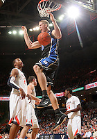 Feb. 16, 2011; Charlottesville, VA, USA; Duke Blue Devils forward Mason Plumlee (5) dunks the ball in front of Virginia Cavaliers defenders during the second half of the game at the John Paul Jones Arena. The Duke Blue Devils won 56-41.  Credit Image: © Andrew Shurtleff