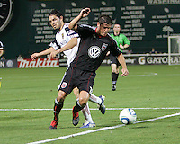 Devon McTavish #18 of D.C. United gets the ball away from Fabian Espindola #7  of Real Salt Lake during an Open Cup match at RFK Stadium, on June 2 2010 in Washington DC. DC United won 2-1.