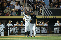 Wake Forest Demon Deacons head coach Tom Walter (right) gives instructions to Jake Mueller (6) during the game against the West Virginia Mountaineers in Game Four of the Winston-Salem Regional in the 2017 College World Series at David F. Couch Ballpark on June 3, 2017 in Winston-Salem, North Carolina.  The Demon Deacons walked-off the Mountaineers 4-3.  (Brian Westerholt/Four Seam Images)