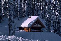 Snow Covered Log Cabin at Stagleap Provincial Park, Kootenay Pass Summit, BC,  British Columbia, Canada - BC Rockies Region, Winter