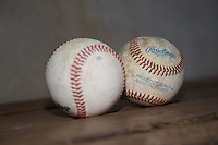 A pair of Rawlings minor league practice baseballs sit on the bench in the home dugout at BB&T Ballpark prior to the Carolina League game between the Salem Red Sox and the Winston-Salem Dash on April 15, 2016 in Winston-Salem, North Carolina.  The Red Sox defeated the Dash 3-2.  (Brian Westerholt/Four Seam Images)