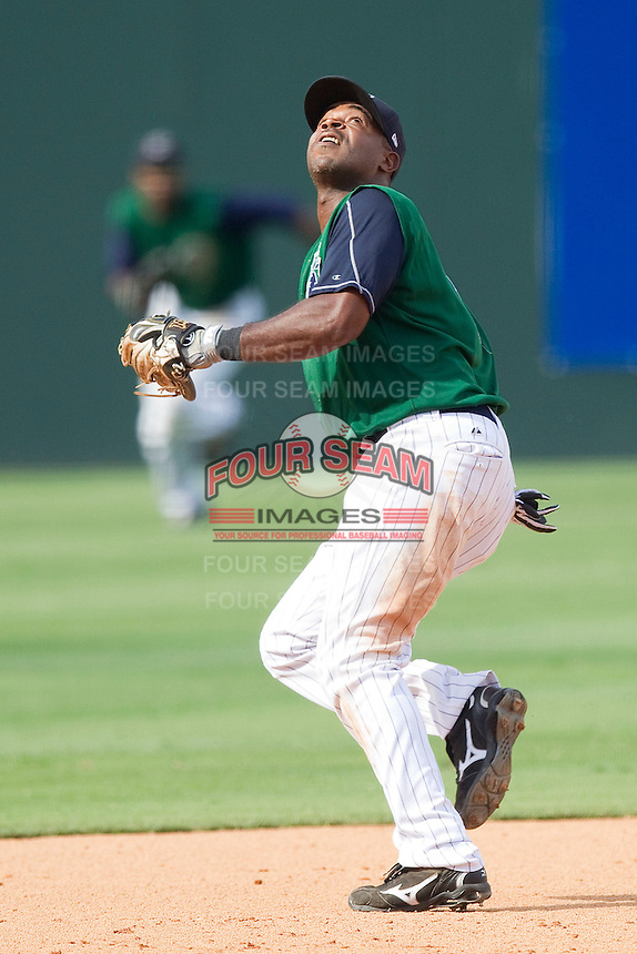 Third baseman Gookie Dawkins #9 of the Charlotte Knights tracks a fly ball against the Syracuse Chiefs at Knights Stadium on June 19, 2011 in Fort Mill, South Carolina.  The Knights defeated the Chiefs 10-9.    (Brian Westerholt / Four Seam Images)