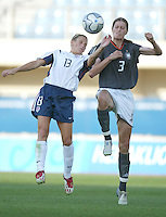 23 August 2004:   Kristine Lilly battles for the ball in the air against Kerstin Garefrekes during the semifinal game at Pankritio Stadium in Heraklio, Greece.     USA defeated Germany, 2-1 in overtime,  .   Credit: Michael Pimentel / ISI
