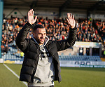 Dundee new signing Steven Caulker applauds the fans as he does the half time draw